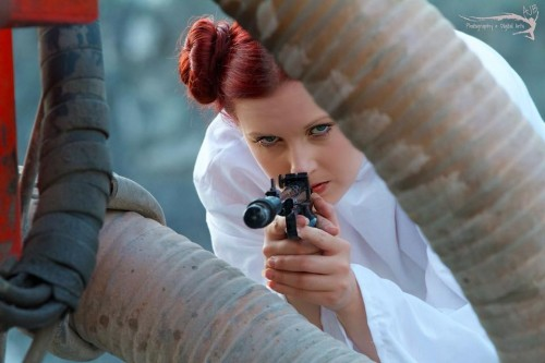 Princess Leia - Star Wars. Hairstylist: Tracy Mellon. Handcrafted Costume by: Pete Mellon. Laser Blaster painted by: Justin Hodgins. Photographer: Alexander Bordeaux. Organizer: Mike Giovinazzo